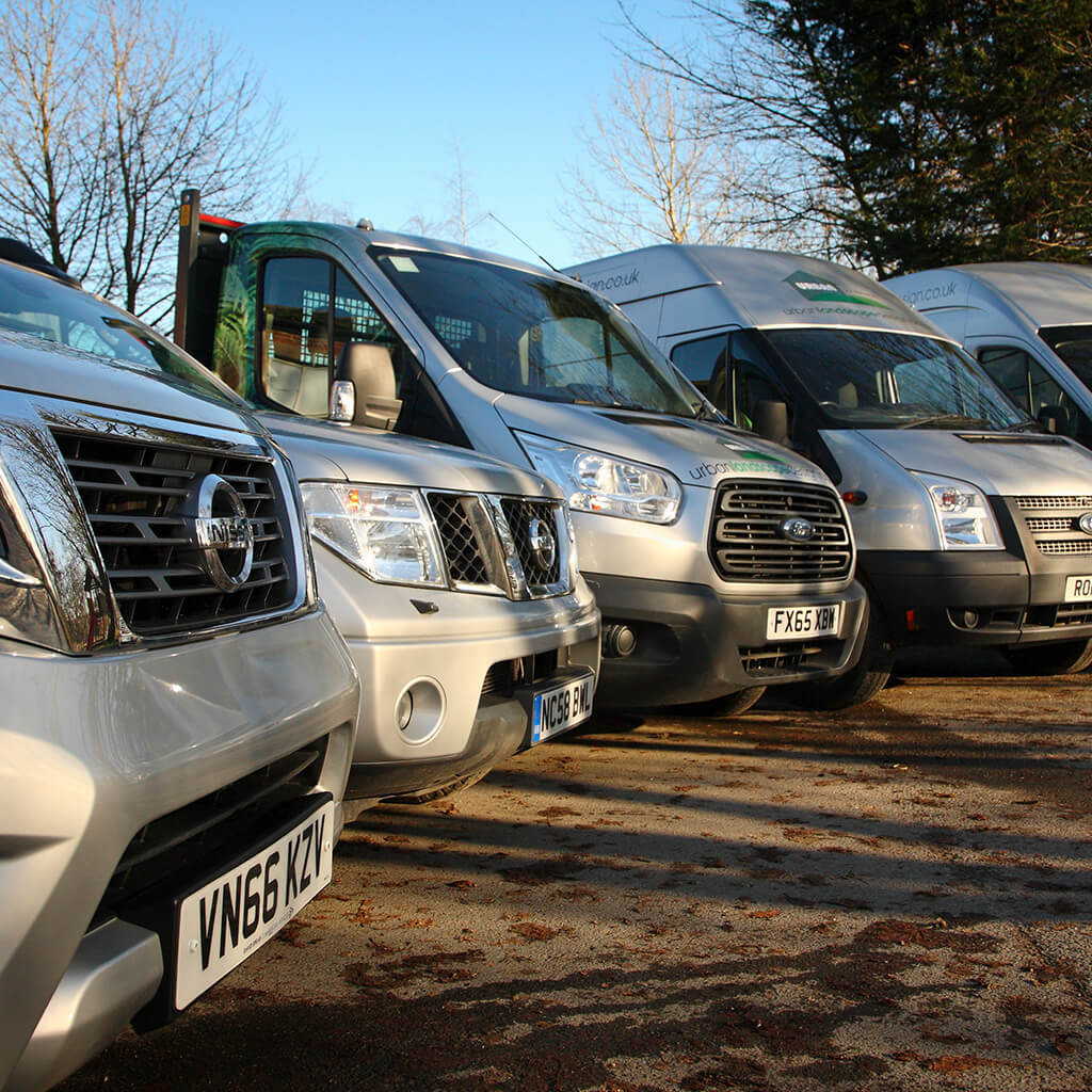 A large fleet of landscaping vans and trucks